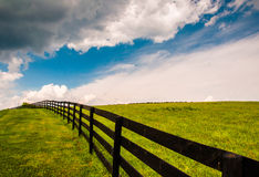 Beautiful summer sky over fence and field in Southern York Count Stock Images