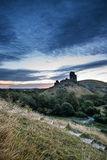 Beautiful Summer sunrise over landscape of medieval castle ruins Royalty Free Stock Photography