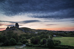 Beautiful Summer sunrise over landscape of medieval castle ruins Royalty Free Stock Photos