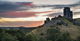 Beautiful Summer sunrise over landscape of medieval castle ruins Royalty Free Stock Images