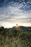 Beautiful Summer sunrise over landscape of medieval castle ruins Stock Image
