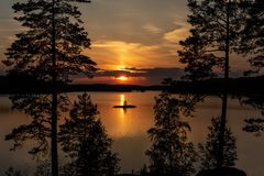 Beautiful summer sunset. Beautiful and colorful summer sunset by forest lake stock image