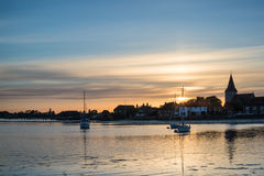 Beautiful Summer sunset landscape over low tide harbor with moor Stock Photography