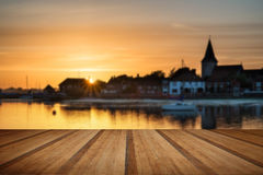 Beautiful Summer sunset landscape over low tide harbor with moor Stock Image
