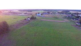 Beautiful summer sunset. Old church. Green fields and forest. Aerial footage. stock video