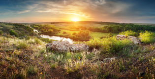 Beautiful summer sunset at the river with reflection Royalty Free Stock Photos