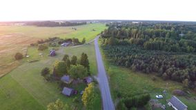Beautiful summer sunset. Road / alley. Green fields and forest. Aerial footage. stock video footage