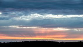 Beautiful Summer sunset sky with colorful vibrant cloud formatio. Ns Stock Photo