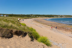 Beautiful summer sunshine and warm weather drew visitors to the beach at Port Eynon, The Gower, Wales Royalty Free Stock Image