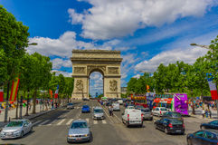 Beautiful summer view of Champs Elysees and Arc de Stock Photos
