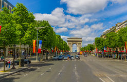 Beautiful summer view of Champs Elysees and Arc de. PARIS, FRANCE - JUNE 1, 2015: Beautiful view of Champs Elysees boulevard with Arc de Triomphe in the Stock Photos