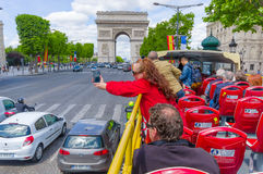 Beautiful summer view of Champs Elysees and Arc de. PARIS, FRANCE - JUNE 1, 2015: City tour bus with tourists in Champs Elysees and Arc de Triomphe royalty free stock photo