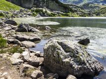 Beautiful summer view to the seaweed surface of the Fish Lake, one of the Seven Rila Lakes at Rila Mountains, Bulgaria royalty free stock photos