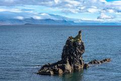 West coastline of Iceland with strange lava formation. Beautiful summer view of the West coastline of Iceland with a strange looking lava or basalt formation in royalty free stock photography