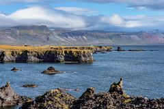 Beautiful summer view of the west coastline of Iceland. Sunny view of the west coastline of Iceland with a steep edge of lava cliffs down to the Atlantic ocean royalty free stock image