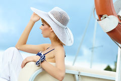 Beautiful summer woman in hat Stock Images