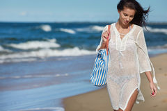 Beautiful summer woman near the sea Royalty Free Stock Photo