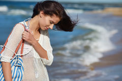 Beautiful summer woman near the sea Stock Image