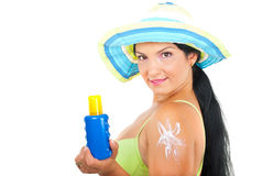 Beautiful summer woman with sun protection lotion Stock Photos