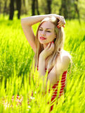 Beautiful summer young woman in green grass Royalty Free Stock Photos