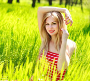 Beautiful summer young woman in green grass Stock Photo