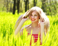 Beautiful summer young woman in green grass Stock Images