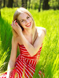 Beautiful summer young woman in green grass Royalty Free Stock Photo