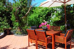 Free Beautiful Summertime Mediterranean Style Courtyard Garden Setting. Royalty Free Stock Photos - 151364738