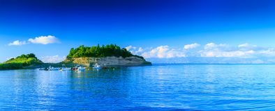 Beautiful summertime panoramic seascape. View of the cliff called Small D`Amour Canal, into the crystal clear azure sea bay and d stock images