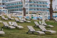 Beautiful sun loungers on the lawn near the hotel Royalty Free Stock Photos