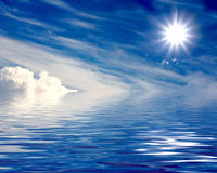 Beautiful sun over clouds and water Royalty Free Stock Photos