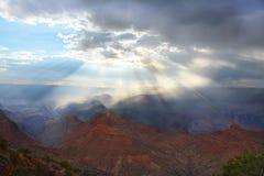 Beautiful sun rays coming through clouds illuminating beautiful mountains. Stock Image