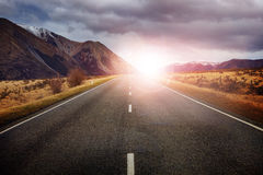 Beautiful sun rising sky with asphalt highways road against snow Stock Photography