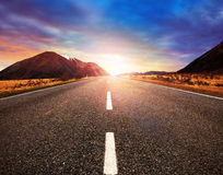 Beautiful sun rising sky with asphalt highways road in rural sce Stock Images
