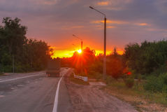 Beautiful sun rising sky with asphalt highways road in rural scene Stock Photo