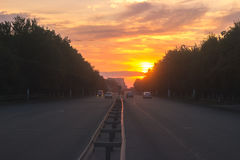 Beautiful sun rising sky with asphalt highways road in rural scene Stock Photos