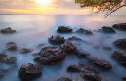 Beautiful sun rising sky at sea beach with long exposure photogr Stock Photography