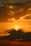 Beautiful sun sets behind the horizon Royalty Free Stock Photo