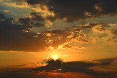 Beautiful sun sets behind the horizon Stock Image