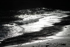 Beautiful sun sparkle on beach waves Stock Photo