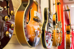 Beautiful sunburst electric guitar in the shop Stock Photography