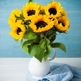 Beautiful sunflowers bouquet in white vase Stock Photos