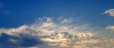 Beautiful golden sunlight shine through cloudscape royalty free stock photo