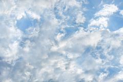 Beautiful sunlit clouds in the blue sky stock image