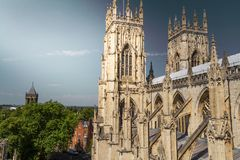Beautiful sunlit view of the spires of York Minster Cathedral with the town in sight in Yorkshire, England stock image