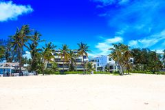 Beautiful sunny day on the beach and modern apartments, Punta Cana. Beautiful sunny day on the beach, Punta Cana, Dominican Republic Royalty Free Stock Photos