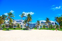 Beautiful sunny day on the beach and modern apartments, Punta Cana. Beautiful sunny day on the beach, Punta Cana, Dominican Republic Stock Image