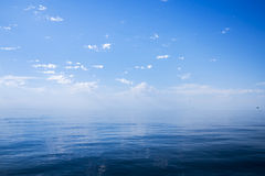 Beautiful sunny day with blue sky over the sea. Royalty Free Stock Image
