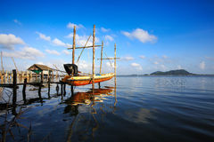 Beautiful sunny day. Beautiful cloud and sky with wooden boat on lake Stock Photos