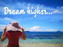 Dream higher and a beautiful sunny day and a woman standing looking away further way ocean view. stock photos